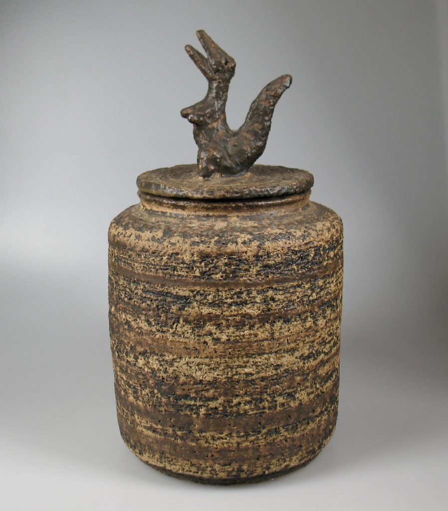 Large lidded pot by Jan van Stolk with a small dragonlike figurine on top.